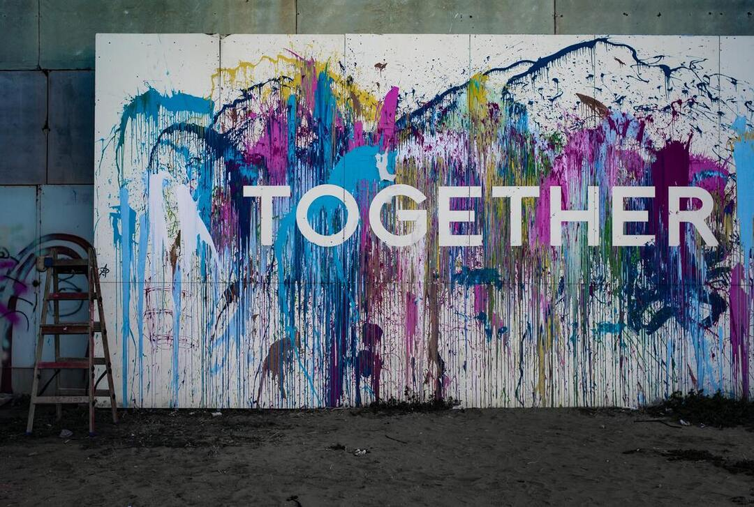 mural with paint splashes and the words togetherness to represent community and unity in Los Angeles